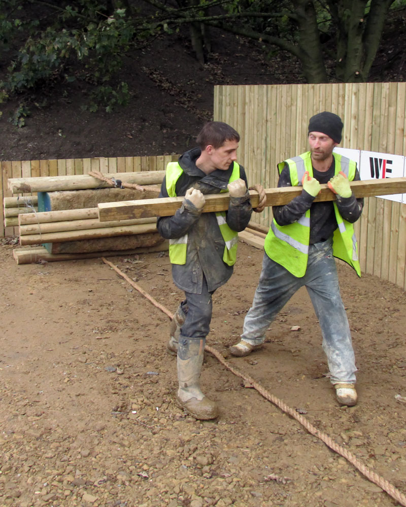 Getting involved - two men pull a the tonne test block
